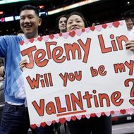 Fans of Jeremy Lin #17 of the New York Knicks cheer during a game against the Toronto Raptors at the Air Canada Centre February 14, 2012 in Toronto, Ontario, Canada.