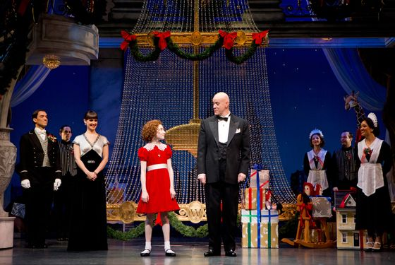 (l-r) Brynn O'Malley (Grace Farrell), Lilla Crawford (Annie), Anthony Warlow (Oliver Warbucks) and Ensemble in ANNIE at the Palace Theatre (Broadway at 47th Street). ANNIE features a book by Thomas Meehan, music by Charles Strouse and lyrics by Martin Charnin.  Th