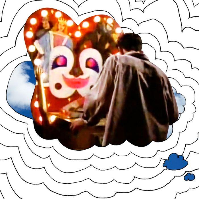 Boy playing pinball machine in thought bubble.