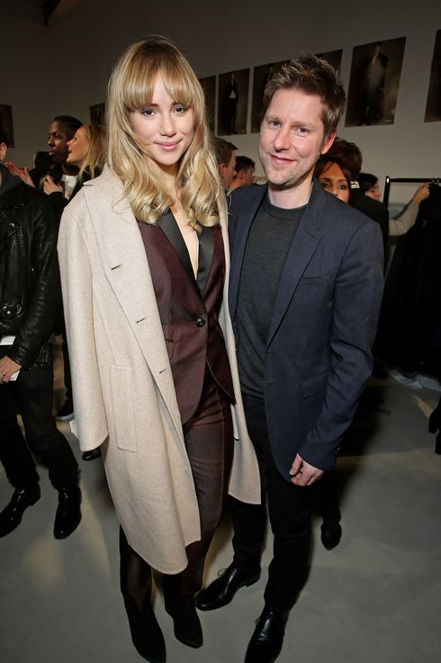 LONDON, ENGLAND - JANUARY 08:  Suki Waterhouse (L) and Burberry Chief Creative Officer Christopher Bailey poses backstage during the Burberry AW14 Menswear Show at Kensington Gardens on January 8, 2014 in London, England.  (Photo by Mike Marsland/WireImage for Burberry)