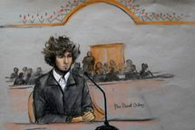 In this courtroom sketch, Boston Marathon bombing suspect Dzhokhar Tsarnaev is depicted sitting in federal court in Boston Thursday, Dec. 18, 2014, for a final hearing before his trial begins in January. Tsarnaev is charged with the April 2013 attack that killed three people and injured more than 260. He could face the death penalty if convicted.  (AP Photo/Jane Flavell Collins)