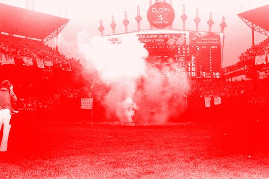 View of the smoke from a huge crate of disco records, just prior to its detonation as part of an anti-disco promotion at Comiskey Park, Chicago, Illinois, July 12, 1979. The event, held between games of a doubleheader between the Chicago White Sox and the Detroit Tigers, allowed fans to attend the games for 98 cents along with an unwanted disco record, and eventually resulted in the White Sox forfeiture of the second game due to unsafe playing conditions when fans stormed the field causing serious damage to the venue and playing surface. (Photo by Paul Natkin/Getty Images)