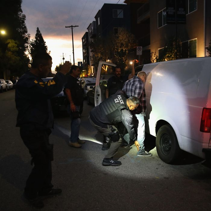 ICE agents carrying out an arrest.