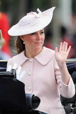 Catherine, Duchess of Cambridge rides in a carriage back to Buckingham Palace during the annual Trooping the Colour Ceremony on June 15, 2013 in London, England. Today's ceremony which marks the Queens official birthday will not be attended by Prince Philip the Duke of Edinburgh as he recuperates from abdominal surgery and will also be The Duchess of Cambridge's last public engagement before her baby is due to be born next month.