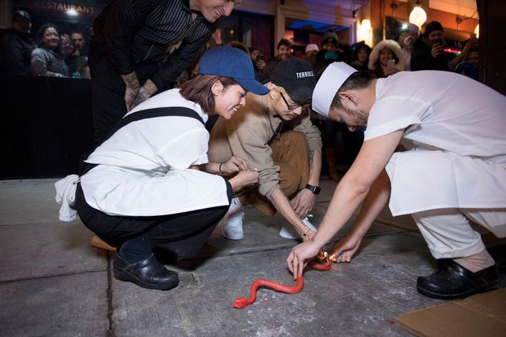 The festivities started with a custom-made smoke bomb in the shape of a snake.