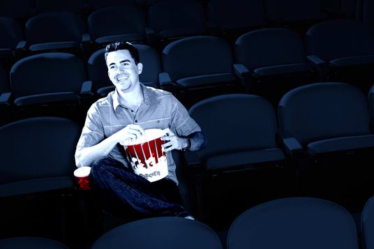 Man Watching Movie in Empty Theater --- Image by ? moodboard/Corbis