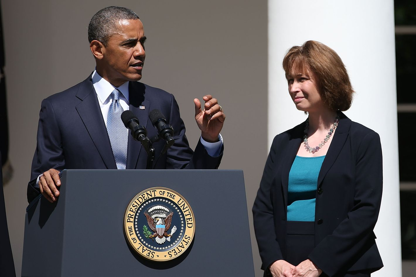 WASHINGTON, DC - JUNE 04:  U.S. President Barack Obama gestures while nominating Patricia Ann Millett (R), an appellate lawyer, to become a federal judge, during an event in the Rose Garden at the White House June 4, 2013 in Washington, DC. If confirmed by the U.S. Senate the three nominees will fill three vacancies on United States Court of Appeals for the District of Columbia.  (Photo by Mark Wilson/Getty Images)