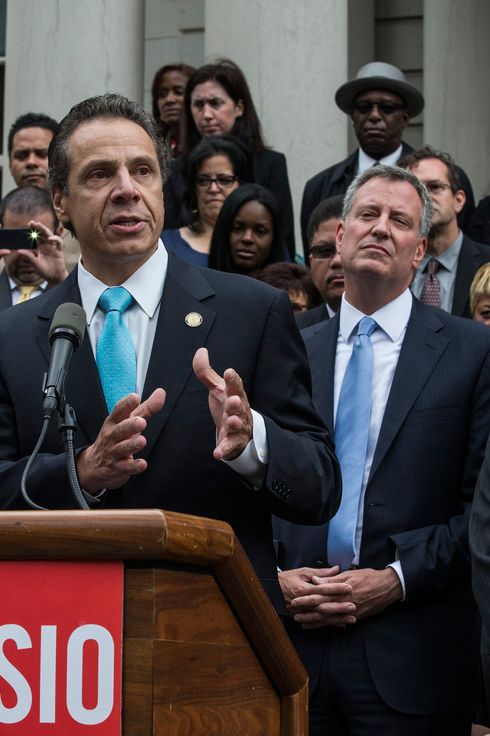 NEW YORK, NY - SEPTEMBER 16:  New York Governor Andrew Cuomo, (L) speaks outside New York City Hall after New York City mayoral hopeful Bill Thompson (R) conceded defeat to New York City Democratic mayoral candidate Bill De Blasio (C), on September 16, 2013 in New York City. Thompson and De Blasio both hoped to win the democratic cadidate position for New York City. While De Blasio had a majority lead in the primary vote with approximately 40% of the votes, Thompson had hoped that he could force a run off between the two.  (Photo by Andrew Burton/Getty Images)