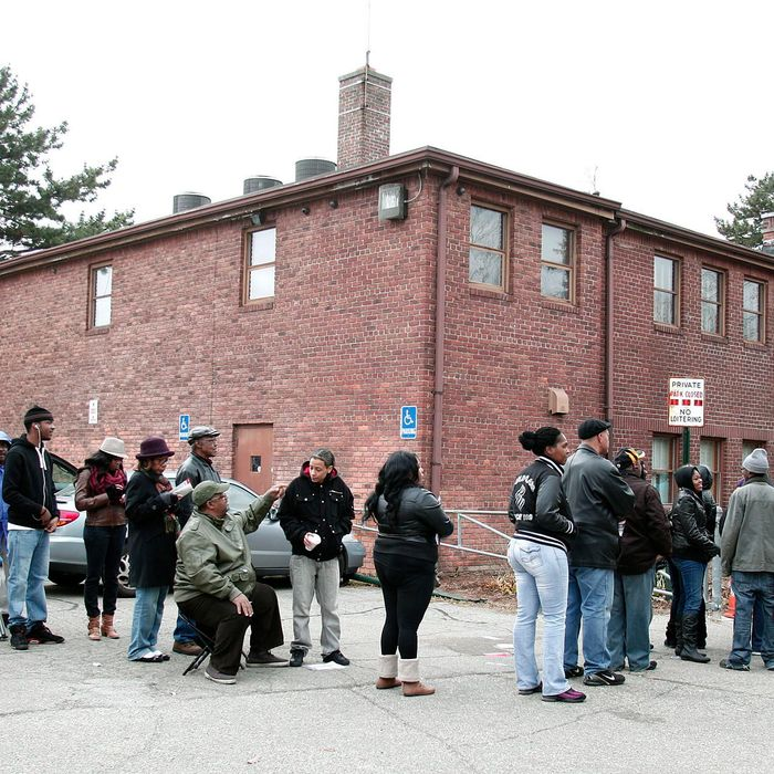 DETROIT, MI - NOVEMBER 6: U.S. citizens wait in a long line to vote in the presidential election at Community House November 6, 2012 in Detroit, Michigan. The race between Democratic President Barack Obama and Republican nominee former Massachusetts Gov. Mitt Romney remains tight as Americans head to the polls to cast their ballots. (Photo by Bill Pugliano/Getty Images)