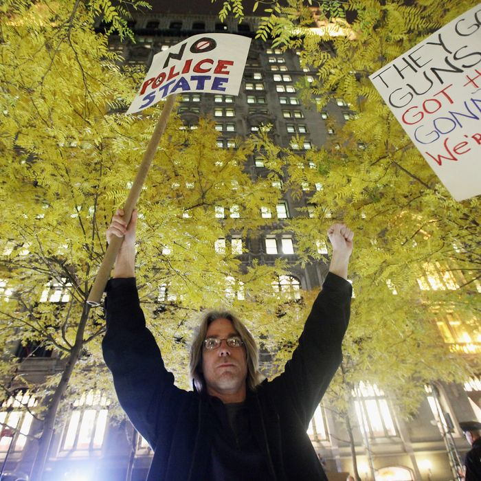 NEW YORK, NY - NOVEMBER 15: A protester celebrates after re-entering Zuccotti Park after police removed the Occupy Wall Street protesters from the park early in the morning on November 15, 2011 in New York City. Police had removed the protesters from the park early in the morning. A judge ruled that protesters are allowed back to the park but won't be allowed to camp there. Hundreds of protesters, who rallied against inequality in America, have slept in tents and under tarps since September 17 in Zuccotti Park, which has since become the epicenter of the global Occupy movement. The raid in New York City follows recent similar moves in Oakland, California, and Portland, Oregon. (Photo by Mario Tama/Getty Images)