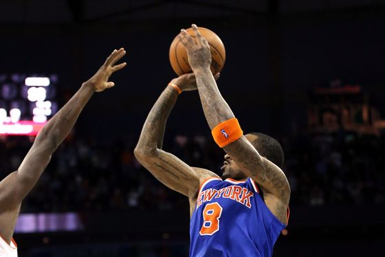 CHARLOTTE, NC - DECEMBER 05:  J.R. Smith #8 of the New York Knicks shoots the game winning shot as time expires to defeat the Charlotte Bobcats 100-98 during their game at Time Warner Cable Arena on December 5, 2012 in Charlotte, North Carolina. NOTE TO USER: User expressly acknowledges and agrees that, by downloading and or using this photograph, User is consenting to the terms and conditions of the Getty Images License Agreement.  (Photo by Streeter Lecka/Getty Images)