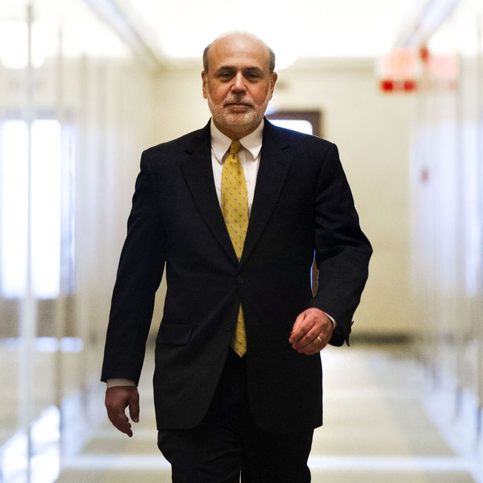 Ben Bernanke, chairman of the Federal Reserve, walks down a hallway to an elevator as he leaves his office on his last day as chairman, at the Federal Reserve in Washington, DC, January 31, 2014. Janet Yellen starts as the first woman to lead the Federal Reserve on February 1. AFP PHOTO / Saul LOEB (Photo credit should read SAUL LOEB/AFP/Getty Images)