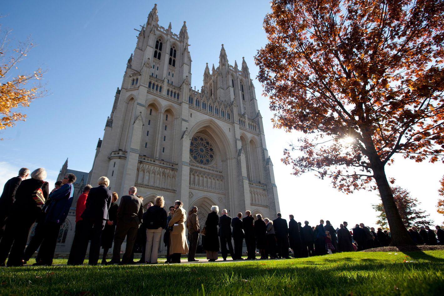 People wait outside the Washington National Cathedral before the consecration service of Washington's first woman and 9th Episcopal Bishop, the Rev. Mariann Edgar Budde, Saturday, Nov. 12, 2011.