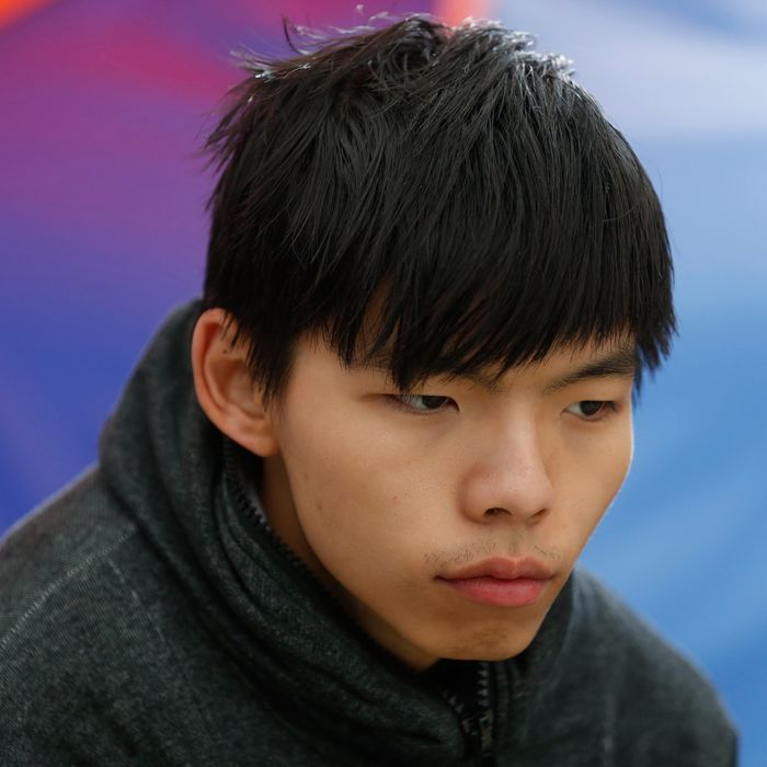 Student leader Joshua Wong sits next to his tent during his hunger strike at the occupied area outside government headquarters in Hong Kong Tuesday, Dec. 2, 2014. A prominent Hong Kong teen protest leader said Monday he's going on a hunger strike after a failed attempt by pro-democracy activists to step up their flagging movement for democratic reforms by surrounding government headquarters. (AP Photo/Kin Cheung)