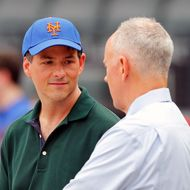 NEW YORK, NY - AUGUST 06:  New York Mets General Manager Sandy Alderson (tie) and prospective owner David Einhorn (green shirt) talk as they watch batting practice before a Major League Baseball game against the Atlanta Braves at Citi Field on August 6, 2011 in New York City.  (Photo by Paul Bereswill/Getty Images)