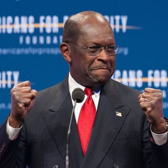 US Republican presidential hopeful Herman Cain arrives to address the