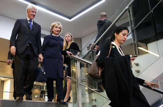 JOHANNESBURG, SOUTH AFRICA - DECEMBER 10:  (L-R) Former U.S. President Bill Clinton, former Secretary of State Hillary Clinton, their daughter Chealsea Clinton and Huma Abedin leave the official memorial service for former South African President Nelson Mandela at FNB Stadium December 10, 2013 in Johannesburg, South Africa. Over 60 heads of state have travelled to South Africa to attend a week of events commemorating the life of former South African President Nelson Mandela. Mr Mandela passed away on the evening of December 5, 2013 at his home in Houghton at the age of 95. Mandela became South Africa's first black president in 1994 after spending 27 years in jail for his activism against apartheid in a racially-divided South Africa.  (Photo by Chip Somodevilla/Getty Images)