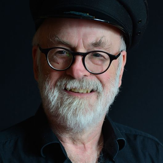LONDON, UNITED KINGDOM - SEPTEMBER 18: Portrait of English fantasy author Sir Terry Pratchett, photographed to promote the 40th novel in his Discworld series, Raising Steam, on September 18, 2013. (Photo by Kevin Nixon/SFX Magazine via Getty Images)