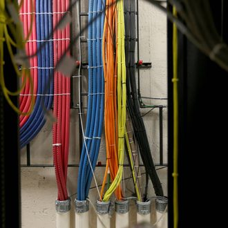 Cables at a Comcast distribution center are seen where the Comcast regional video, high speed data and voice are piped out to customers on February 13, 2014 in Pompano Beach, Florida. Today, Comcast announced a $45-billion offer for Time Warner Cable.