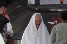 "David Cross & Portia de Rossi film film a scene for ""Arrested Development""."