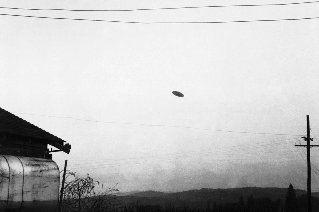 11 May 1950, McMinnville, Oregon, USA --- Original caption: 5/11/1950-Minnville, OR: A picture of a flying saucer photographed by farmer Paul Trent shown flying over his farm. --- Image by ? Bettmann/CORBIS