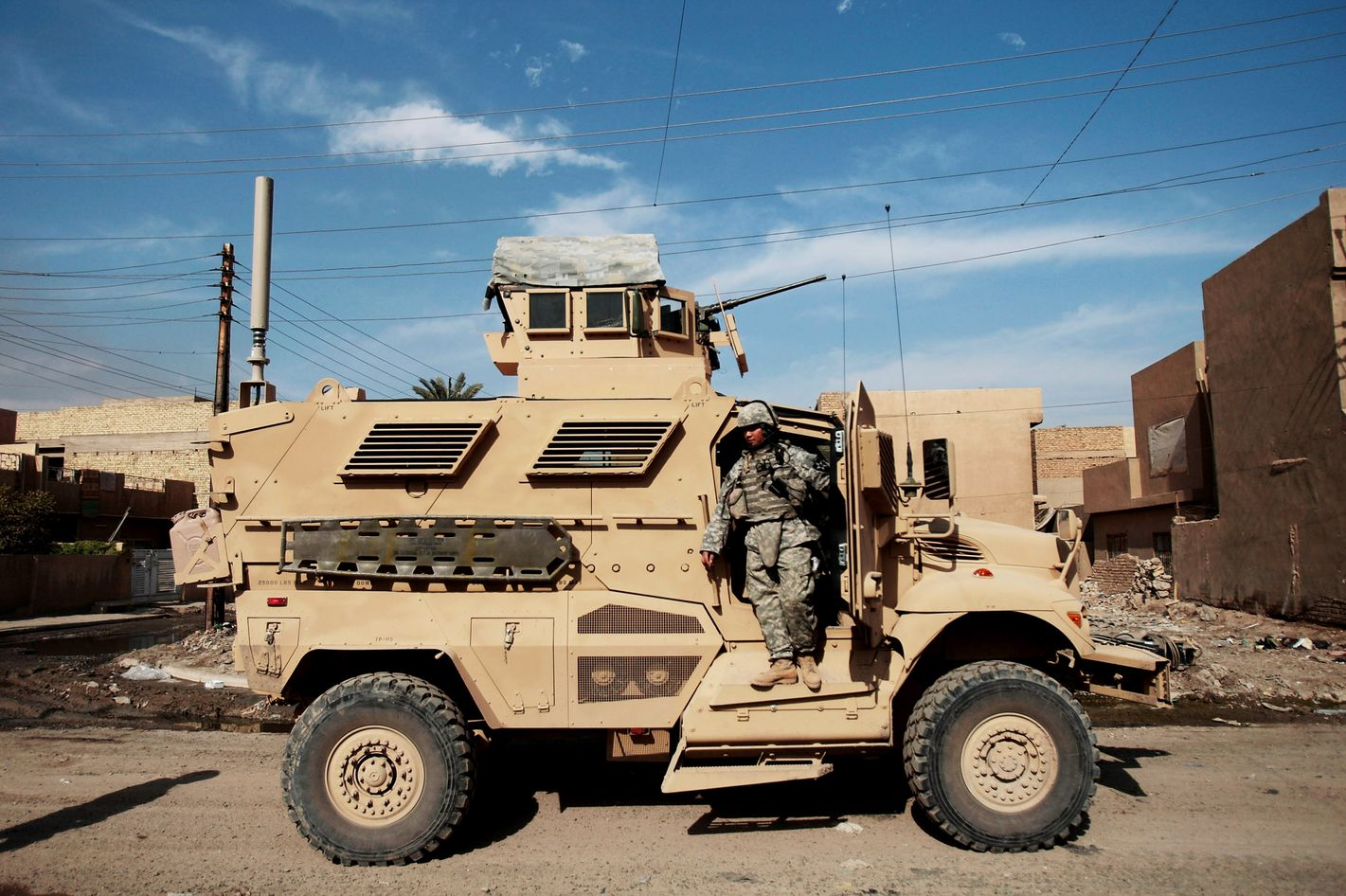 A soldier with the U.S. Army's  2-12 infantry stands on a  MRAP vehicle while on patrol  November 17, 2007  in Baghdad, Iraq.  MRAPs are a family of mine-resistant transport vehicles; a set recently arrived at FOB Falcon are simply called MRAPs by the soldiers but are technically called International MaxxPro Category 1.  Some commanders in the U.S.  military see MRAPs as eventual replacements for the ageing Humvee, though the vehicles large size and other factors have given other commanders paU.S. e.  MRAPs have a V-shaped hull that allows it to better withstand the blasts of roadside bombs.
