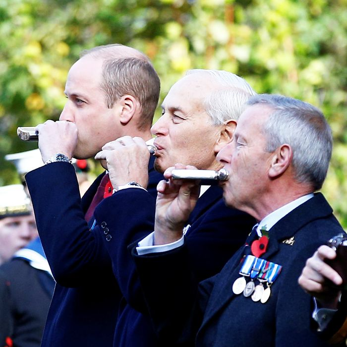 Prince William drinking out of a flask.
