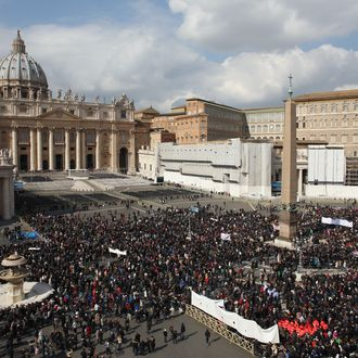 VATICAN CITY, VATICAN - FEBRUARY 24: Crowds gather to see Pope Benedict XVI deliver his last Angelus Blessing from the window of his private apartment to thousands of pilgrims gathered in Saint Peter's Square on February 24, 2013 in Vatican City, Vatican. The Pontiff will hold his last weekly public audience on February 27, 2013 before he retires the following day. Pope Benedict XVI has been the leader of the Catholic Church for eight years and is the first Pope to retire since 1415. He cites ailing health as his reason for retirement and will spend the rest of his life in solitude away from public engagements. (Photo by Oli Scarff/Getty Images)