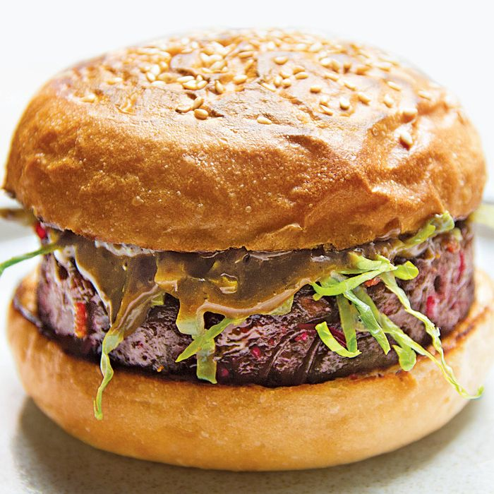 The patty for the veggie burger is made with beets, lentils, and vermicelli noodles, and topped with black-garlic aioli and shredded lettuce.