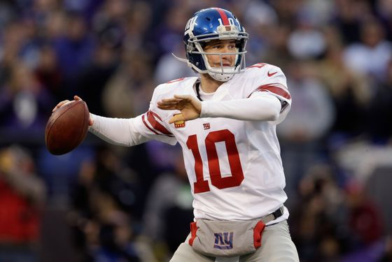 Quarterback Eli Manning #10 of the New York Giants drops back to pass against the Baltimore Ravens at M&T Bank Stadium on December 23, 2012 in Baltimore, Maryland.