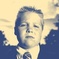 Boy (8-10) wearing school uniform, portrait