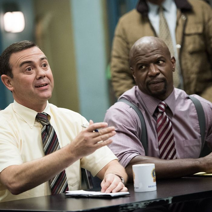 BROOKLYN NINE-NINE: Det. Boyle (Joe Lo Truglio, L) and Sgt. Jeffords (Terry Crews, R) listen in for their next assignment in the
