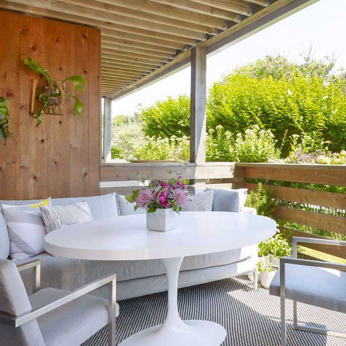 This covered porch is the apartment's main gathering place. Photo: Peter Murdock