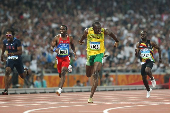 BEIJING - AUGUST 20:  Usain Bolt of Jamaica crosses the finish line as he breaks the world record with a time of 19.30 seconds to win the gold medal in the Men's 200m Final at the National Stadium during Day 12 of the Beijing 2008 Olympic Games on August 20, 2008 in Beijing, China.  (Photo by Jed Jacobsohn/Getty Images)