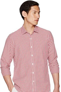 A male model wearing a collared slim-fit long-sleeve red and white gingham plaid poplin shirt from Goodthreads. The Strategist - A Bunch of Men's Button Downs (From $16) Are on Sale at Amazon