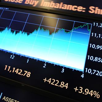 An electronic display shows Dow Jones Industrial Average numbers on the floor of the New York Stock Exchange just after the closing bell on August 11, 2011. US stocks made another dramatic comeback after a stunning fall on Thursday, in another day of extreme volatility in markets around the world. The Dow Jones Industrial Average battled back from Wednesday's 520-point loss with a 3.94 percent gain, adding 422.84 points to close at 11,142.78. The broader S&P 500 rebounded 4.63 percent, up 51.87 points to 1,172.63, while the Nasdaq gained 111.63 points, or 4.69 percent, to 2,492.68. AFP PHOTO/Stan HONDA (Photo credit should read STAN HONDA/AFP/Getty Images)