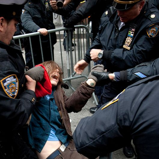 Members of the New York City Police Department (NYPD) arrest a demonstrator in New York, U.S., on Thursday, Nov. 17, 2011. New York police stood prepared for tens of thousands of Occupy Wall Street demonstrators to descend on the Financial District, and ringed the area with metal barricades to deter crowds from reaching their goal of surrounding the New York Stock Exchange. Photographer: Scott Eells/Bloomberg via Getty Images