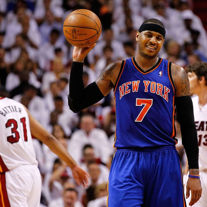 Carmelo Anthony #7 of the New York Knicks reacts to committing a foul during Game Two of the Eastern Conference Quarterfinals in the 2012 NBA Playoffs against the Miami Heat at American Airlines Arena on April 30, 2012 in Miami, Florida.