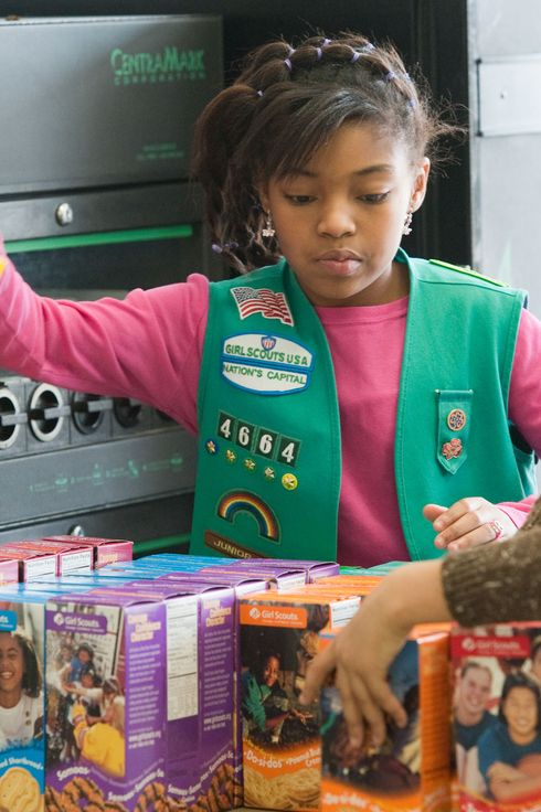 Girl scouts sell cookies at Freeman's Barber Shop in Upper Marlboro, MD.  Lalah Williams, left, 10, of Upper Marlboro, MD, is helping sell the cookies, but has also utilized the internet to become one of the top sellers in the area.  Hilary Foinding, 9, of Upper Marlboro, MD is on the right.