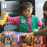 A Girl Scout of America selling cookies last year.
