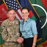"UNSPECIFIED - JULY 13, 2011:  In this handout image provided by the International Security Assistance Force (ISAF), former Commander of International Security Assistance Force and U.S. Forces-Afghanistan; CIA Director Gen. Davis Petraeus (L) shakes hands with biographer Paula Broadwell, co-author of ""All In: The Education of General David Petraeus"" on July 13, 2011. CIA Director Gen. David Petraeus resigned from his post on November 9, 2012, citing an extra-marital affair with Paula Broadwell. The FBI began an investigation after it was tipped off by Jill Kelley, a long-time friend of the Petraeus family, who received threatening emails from Broadwell.  (Photo by ISAF via Getty Images)"