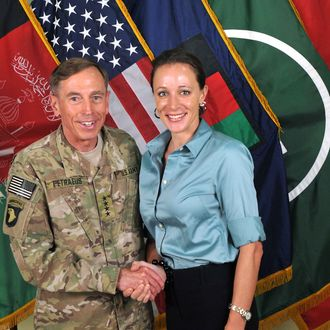UNSPECIFIED - JULY 13, 2011: In this handout image provided by the International Security Assistance Force (ISAF), former Commander of International Security Assistance Force and U.S. Forces-Afghanistan; CIA Director Gen. Davis Petraeus (L) shakes hands with biographer Paula Broadwell, co-author of
