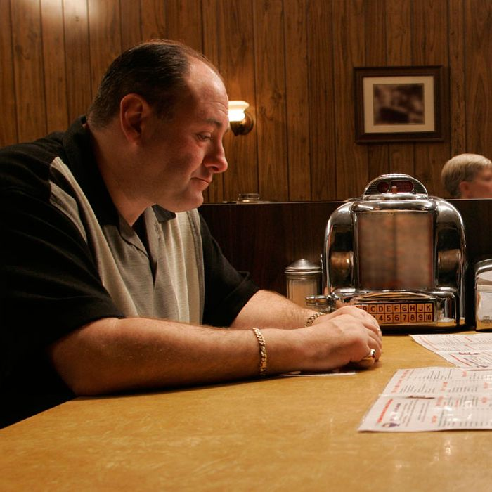 Tony Soprano, Carmela Soprano, and A.J. Soprano in the famous diner scene during The Sopranos series finale.