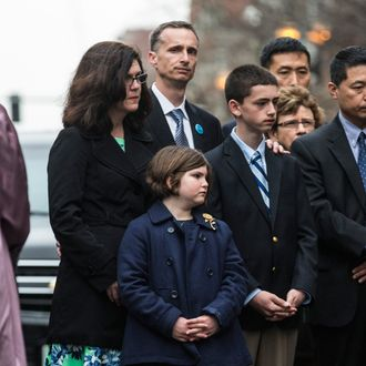 BOSTON, MA - APRIL 15: (L-R) Denise Richard, Bill Richard, Jane Richard and Henry Richard, the family of Martin Richard, an eight-year-old boy killed from a bomb at the Boston marathon, attend a wreath laying ceremony on the one year anniversary of the 2013 Boston Marathon Bombing, on April 15, 2014 in Boston, Massachusetts. Last year, two pressure cooker bombs killed three and injured an estimated 264 others during the Boston marathon, on April 15, 2013. (Photo by Andrew Burton/Getty Images)