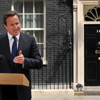 Britain's Prime Minister David Cameron addresses the media outside 10 Downing Street in London, on August 10, 2011, following a fourth night of violence in Britain. Youths smashed their way into stores and torched cars in central England on Tuesday, police said, as Britain's worst riots for decades entered a fourth night. AFP PHOTO / BEN STANSALL (Photo credit should read BEN STANSALL/AFP/Getty Images)