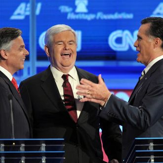 Former House speaker Newt Gingrich (C) and former Massachusetts governor Mitt Romney (R) prior to the start of the Republican presidential debate on national security November 22, 2011.