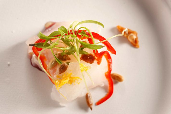 Almanac: Fluke crudo with Concord grapes and pickled shishito peppers.