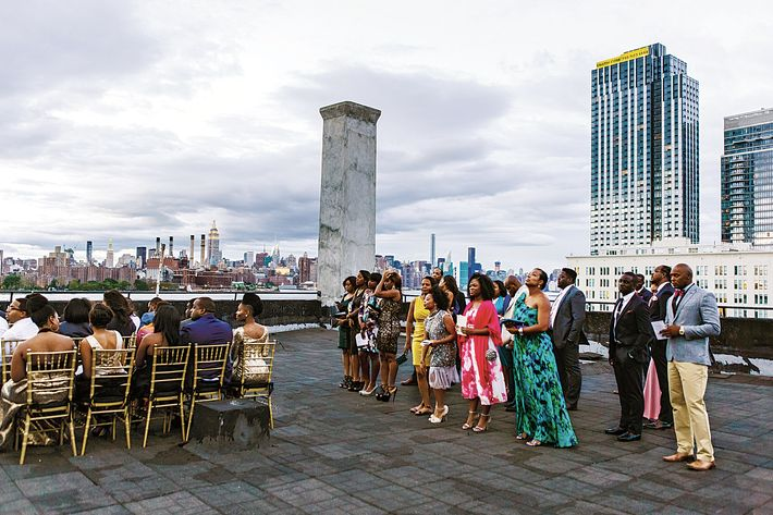 """It rained for two hours before our rooftop ceremony. The chairs were wet, so some people had to stand."""