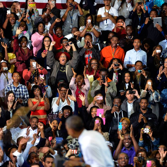Hundreds cheer for President Barack Obama as he delivers remarks on the Affordable Care Act at Prince George's Community College in Largo, Maryland on September 26, 2013.