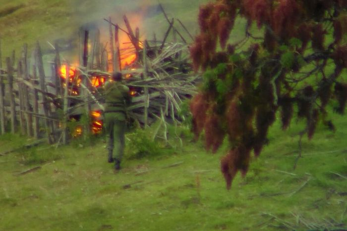 A Kenyan Forest Service official sets a fire to seize control of the land.